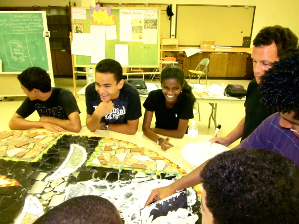 Students from the Latin American Youth Center in DC work on a public mosaic and painting project.