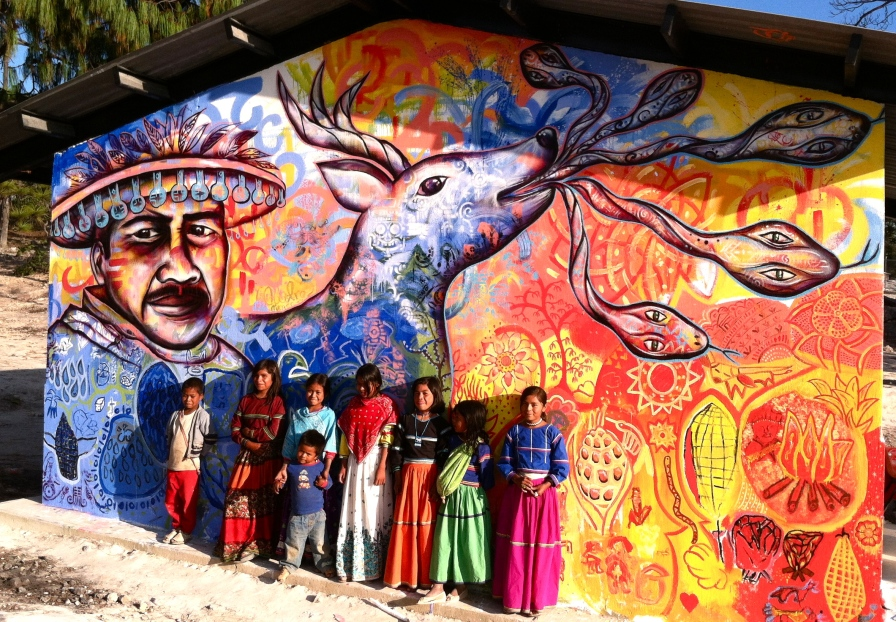 "Mexico 2012: ""El Venado Azul"" was created with a Huichol indigenous community in the remote mountains of Jalisco, Mexico. Everyone contributed their expressions; the larger imagery reflects their spiritual beliefs. Created during Joel's 2012 residency with the Mexican organization IRRI, the International Institute of Renewable Resources (Instituto Internacional de Recursos Renovables), which focuses on green technologies and sustainable development in low-income communities."