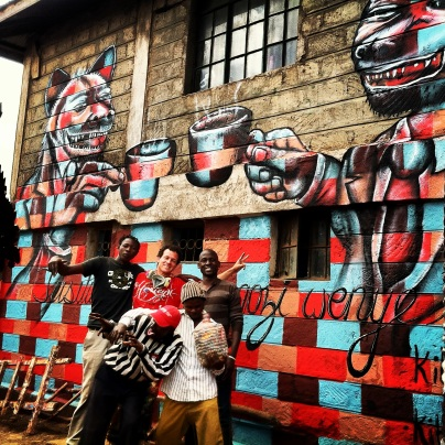 "Nairobi, Kenya 2013: ""Two Hyenas"" encourages Kibera residents not to fight each other on behalf of ""hyenas"" (Kenyan slang for corrupt politicians). Kibera Walls for Peace youth arts project in one of Africa's largest slums; working toward peace for the elections through public art and peace-building workshops with local youth."