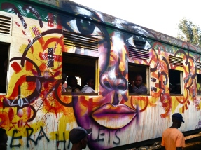 Nairobi, Kenya 2013: The Peace Train! Joel Bergner and his youth artists collaborated with local graffiti artists to paint messages of peace on a huge commuter train that passes through Kibera slums. Kibera Walls for Peace youth arts project in one of Africa's largest slums: working toward peace for the elections through public art and peace-building workshops with local youth.