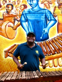 The Afro-Colombian Mural inaugural event in DC: this musician demonstrates the marimba, the central instrument to Currulao music of Colombia's Pacific coast.