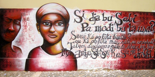 Cape Verde 2011: This mural in Praia features a poem authored by one of the students, who writes of the dangers of drug abuse, a big issue in this neighborhood. The poem is written in the local language Kriolu (creole), which mixes Portuguese with African languages. It is powerful to present Kriolu in public spaces in Cape Verde because the people's language is usually ignored in favor of the official language, Portuguese.