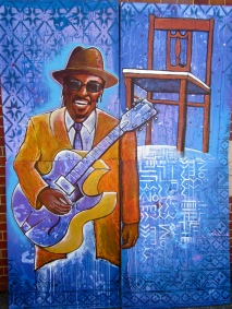 "The ""Godfather of Go-Go,"" the late local legend of DC Chuck Brown, featured in a mural created by students in Joel's after-school program."