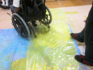Wheelchair art (on top of plastic with wet paint underneath)