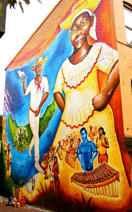 """Currulao y Desplazamiento: The Afro-Colombian Mural"" on U Street in DC, designed by local Afro-Colombians who have asylum in the US due to the armed conflict on the Pacific Coast of Colombia. Funded by the DC Commission on the Arts & Humanities"