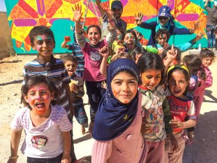 Za'atari Syrian Refugee Camp, Jordan, 2017: Children participating in one of Joel's mural projects