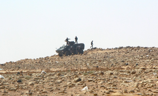 Soldiers with tanks are stationed around the camp to prevent refugees from leaving (photo by Max Frieder)