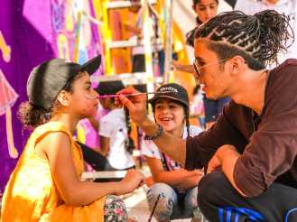 Local artist and dancer Sky, who partnered with us in Amman, doing some face painting.