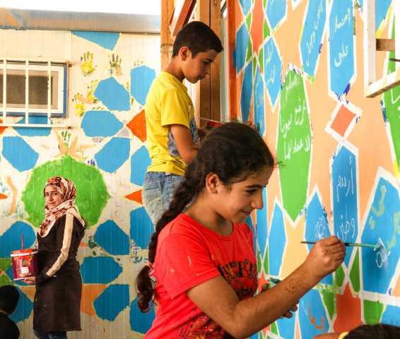 Painting a mural in Za'atari
