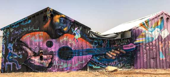 Azraq Syrian Refugee Camp, Jordan 2017: Playing music from the darkness: mural in Azraq Camp.