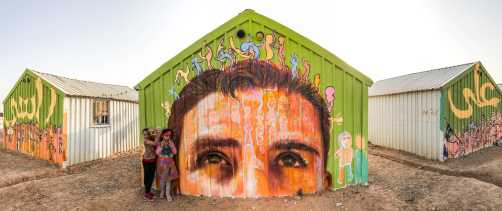 """Za'atari Syrian Refugee Camp, Jordan 2017: """"A La Rasi!"""" This mural is inspired by the Arabic phrase meaning """"I put you on my head,"""" said to show respect and admiration for someone."""
