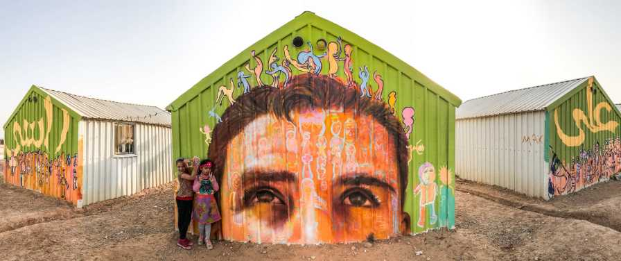 "Za'atari Syrian Refugee Camp, Jordan 2017: ""A La Rasi!"" This mural is inspired by the Arabic phrase meaning ""I put you on my head,"" said to show respect and admiration for someone."
