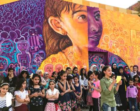 Eihaa reads a poem inspired by her participation in a mural project that bears her likeness.