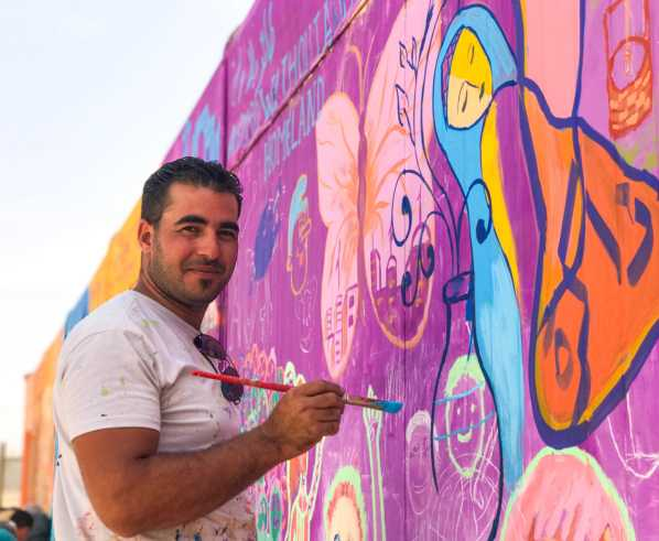 Emad Alkafri, a local artist in Za'atari
