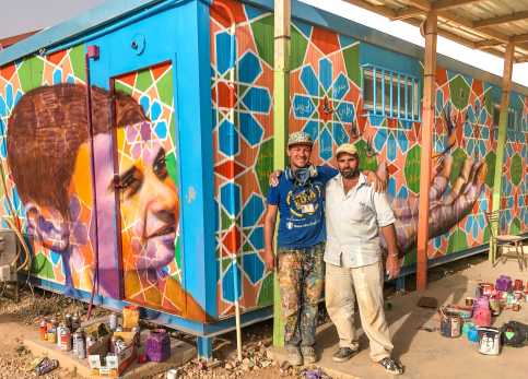 Za'atari Syrian Refugee Camp, Jordan, 2017: Joel with Ali, Syrian artist in Za'atari who creates amazing Arabesque patterns.