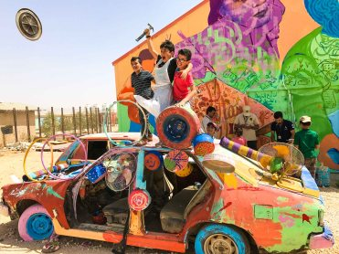 Turning this broken-down car into a work of art in Za'atari Camp