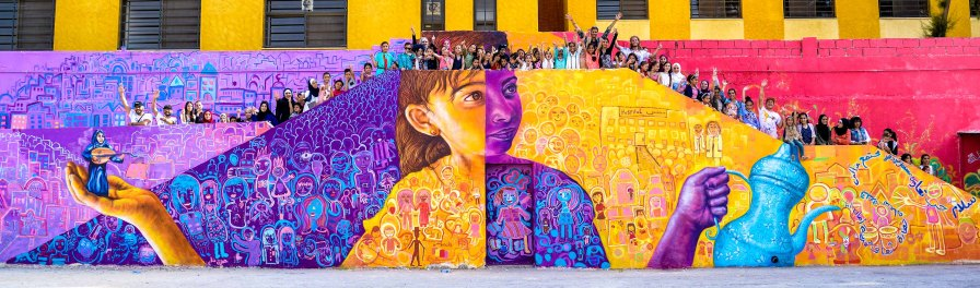 Amman, Jordan 2017: Mural with Syrian and Jordanian girls in Amman