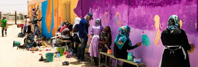 Za'atari Syrian Refugee Camp, Jordan, 2017:Syrians working on a mural in the camp