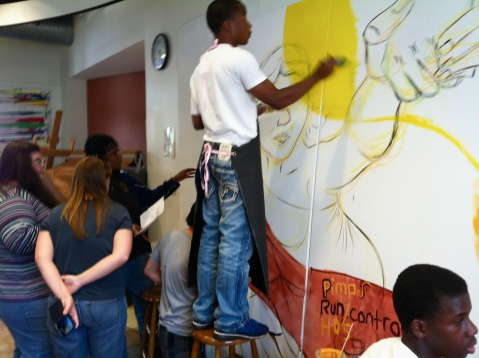 Local high school students contributing to the mural.