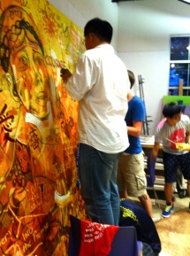 International students contributing to the mural.