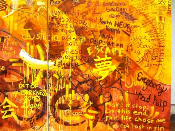 The background of the mural with the poetry and artwork reflecting the students' thoughts on the issue of sex trafficking.