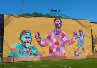 Rio de Janeiro, Brazil 2014: Created for the Street Child World Cup, this giant piece includes the work of former street kids from 19 different countries who traveled to Brazil to meet each other, play in a soccer tournament, participate in arts activities and raise awareness for the plight of street youth around the world. The figure on the left is Rodrigo, the former captain of Team Brazil who was murdered on the streets of Fortaleza on his 14th birthday, only a month before the event. His teammates and friends paid homage to him on the mural. The other two figures are youth participants from India and El Salvador. Each hexagon features the poetry, artwork and messages of the kids.