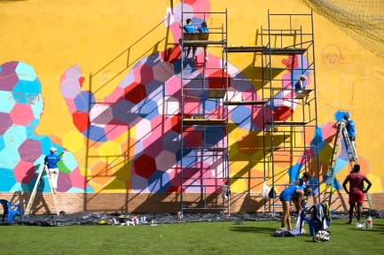 Hundreds of Street Child World Cup participants and staff from all over the world contributed their creativity to the mural: each was given a hexagon to design with words and imagery. Photo provided by Street Child World Cup.