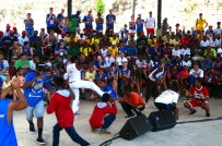 Local Vidigal residents introduce the international kids to capoeira.