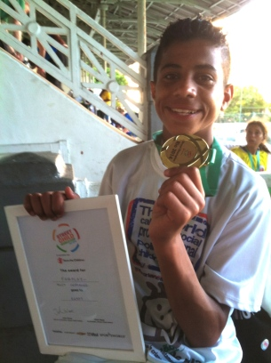 One of the Egyptian players with his medal and certificate at the closing ceremony.