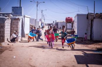 Wheelbarrow art! In Za'atari Syrian Refugee Camp, the wheelbarrow boys are everywhere, smuggling in banned goods from the outside. We led educational workshops with them and decorated wheelbarrows as part of an ongoing project with AptART, ACTED and UNICEF. Photo courtesy of AptART.