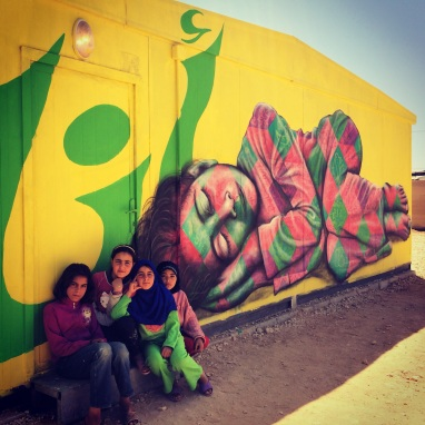 "Za'atari Syrian Refugee Camp, 2014, ""I dream of..."" right side: local kids participated in this mural, expressing their dreams for the future."