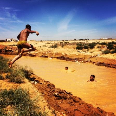 Refugee camp swimming pool! What the kids in Za'atari do to beat the heat...