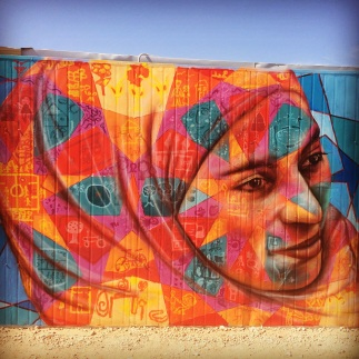 Za'atari Syrian Refugee Camp, 2014: (detail shot) collaboration with local youth, who painted about what they missed most about their homes in Syria in the colored shapes.