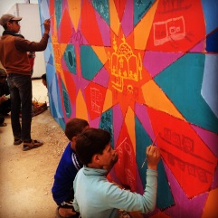 Teens in Za'atari Syrian Refugee Camp paint about what they miss most from home as part of our arts & education project,