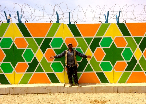 Za'atari Refugee Camp, Jordan 2014: Soft-spoken Syrian artist Ali Kiwan has been beautifying the Za'atari refugee camp where he resides with classic arabesque patterns with a street art influence. Project with aptART, Mercy Corps, ACTED and UNICEF