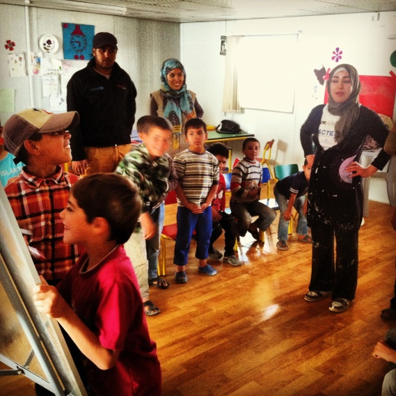 Workshops with Syrian kids in the Za'atari refugee camp focusing on conflict resolution, the arts & education about sanitation, hygiene and water conservation in the camp.