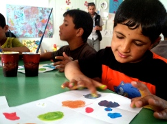 Color- mixing workshop with kids in Za'atari Syrian Refugee Camp.