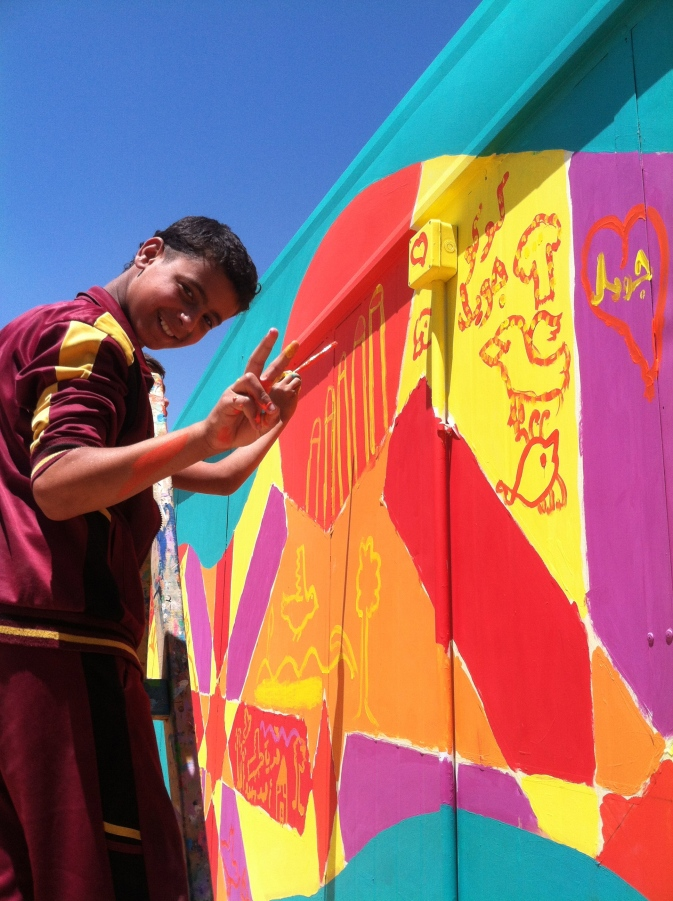 Teenager painting in Za'atari