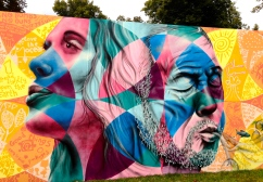 UK, 2014: Joel created an interactive mural as part of the Greenbelt Festival outside of London, which focuses on progressive social causes, music and art. Joel's piece was prominently featured along a long wall in the entrance to the event, and festival- goers were invited to participate in the creation of the piece by adding their poems, drawings and messages on the colored geometric shapes. The theme was the environment; participants were asked to reflect on what we— as individuals and as communities— can do to begin the healing process and reverse the damage done to our natural environment.