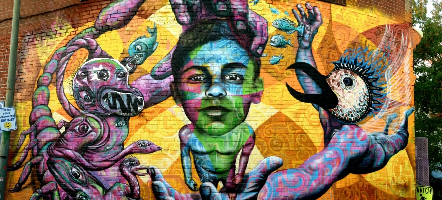 "Washington DC, 2015: ""Felipe's Story"" is the latest of a series of murals on the BloomBars arts center. Felipe is a boy who Joel knows from his many visits to the City of God (Cidade de Deus) community in Rio de Janeiro. Felipe, like many other boys in marginalized neighborhoods, struggles with which path to take: the one of crime, drugs and violence or positivity and healthy relationships."