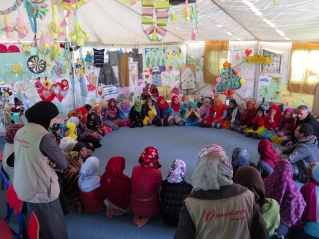 Girls in Azraq Syrian Refugee Camp attend a workshop focused on their goals for their lives and their hopes for the future of their community.