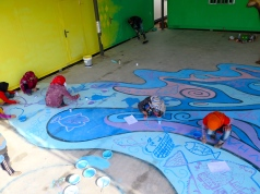 Syrian girls creating a mural in Azraq refugee camp