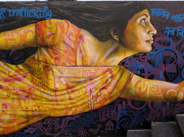 Siliguri, India 2016: Detail shot showing the imagery inside the sari, which depicts stories of human trafficking. The woman is based on a real-life local survivor of trafficking.