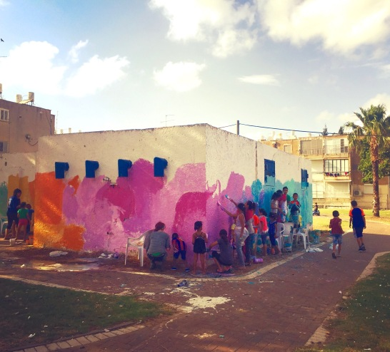 Akko: painting a bomb shelter with Arab and Jewish youth