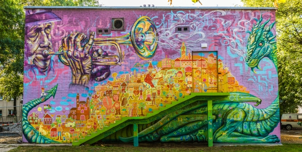 Krakow, Poland 2016: Joel worked with teenagers in foster care to design and paint this community mural that explores local culture and envisions the community and families that the youth envision for their future.