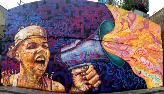 """London, UK 2015: Mural for the Street Child Summit, created by Joel Artista with Bec Dennison, Meghan O'Malley and the """"street youth ambassadors"""" from Brazil, Pakistan and Burundi."""