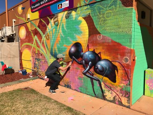 Central Desert, Australia 2017: Joel working on a mural in Alice Springs