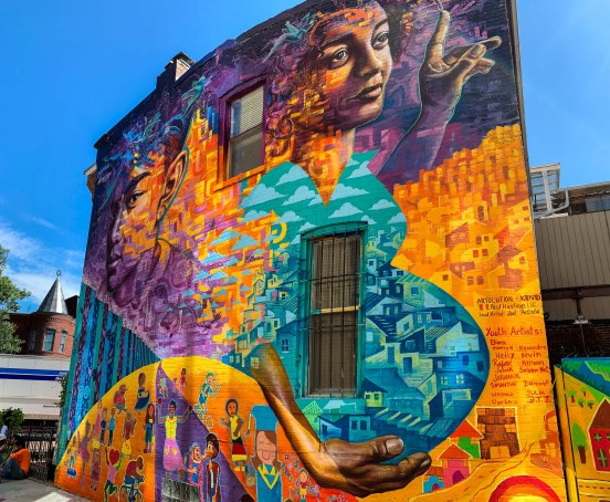 Washington, DC 2019: Created with asylum seekers from Central America, this mural explores the conflicts they've faced and their contributions to their new community. Partners: Artolution, KIND (Kids in Need of Defense) and Paul Hastings Law Firm