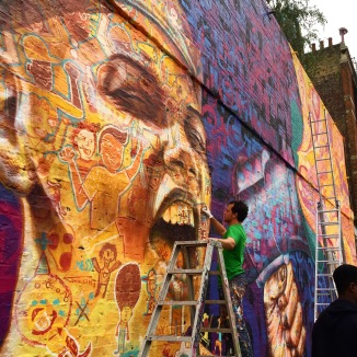 London, UK 2015: Joel at work on one of his trademark portraits that incorporates the characters of many participants.